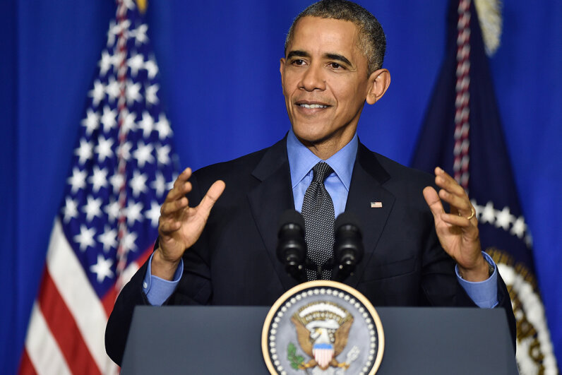 U.S. President Barack Obama speaking behind lectern