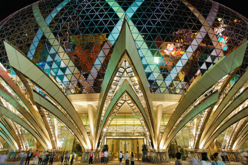 Macau's Grand Lisboa Casino glitters like a crown at night. © Rudy Sulgan/Corbis