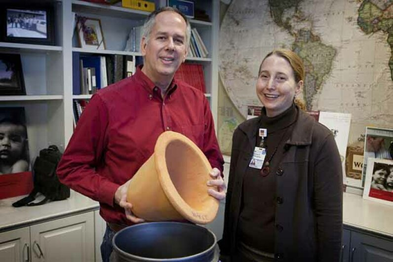 University of Virginia engineer Jim Smith and Dr. Rebecca Dillingham, co-directors of PureMadi, are shown with one of the ceramic water filters their company makes and distributes in South Africa for communities with little access to clean water.  University of Virginia
