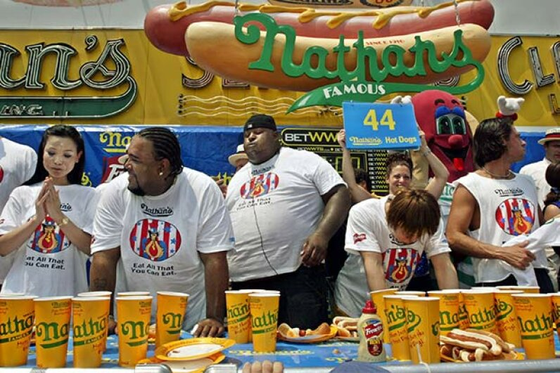 Contestants slump after finishing the annual Coney Island Hot Dog Eating Contest. Wonder how many calories MyFitnessPal would show to each contestant? Chris Hondros/Getty Images