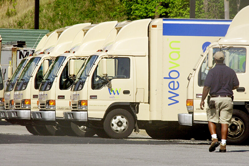 A WebVan employee cleans out some of the company's trucks outside its metro Atlanta distribution office in April 2001. Erik S. Lesser/Getty Images