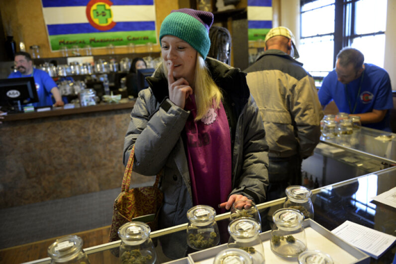 Kristin Brinckerhoff ponders the selection at 3D Cannabis Center, a retail marijana store, in Denver, Colo. In addition to all its other uses, scientists are researching marijuana's antibacterial properties. Craig F. Walker/The Denver Post/Getty Images