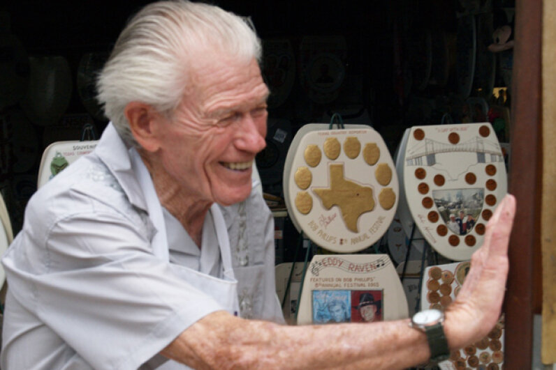 Barney Smith, proprietor of the Toilet Seat Art Museum, shows off some of his masterpieces. iuliegomoll/Flickr