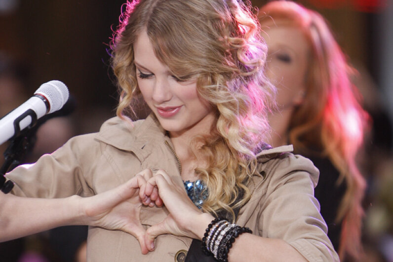 "Taylor Swift makes her ""heart"" gesture at a performance on the Today show. Let's hope she won't get into trouble now that Google has patented it in connection with ""liking"" something via Google Glass. Rahav Segev/WireImage"