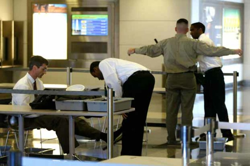 Screeners for the TSA check passengers at Reagan National Airport in Virginia. TSA screeners have seen some pretty outrageous items in passengers' luggage over the years. Mark Wilson/Getty Images