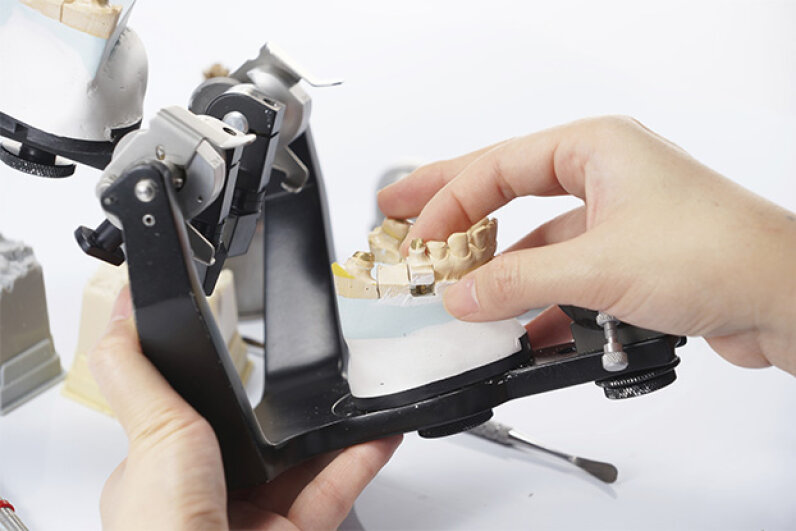 University of Florida researchers have created a set of smart dentures, equipped with sensors that continuously measure the pressure and friction inside a person's mouth. pixs4u/iStock/Thinkstock