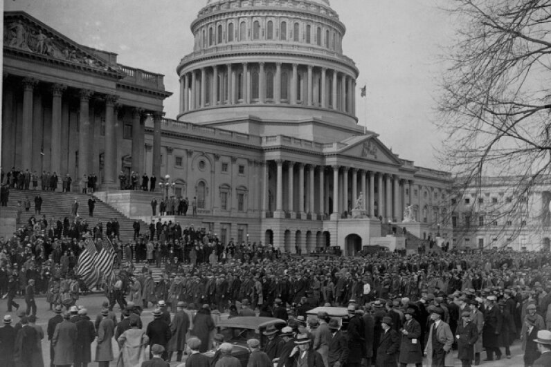 More than 10,000 unemployed Americans convened at the U.S. Capitol building in 1932 to present petitions for relief. They probably wouldn't have minded the efforts to limit the gap between rich and poor in 1933. Library of Congress/Corbis/VCG via Getty Images