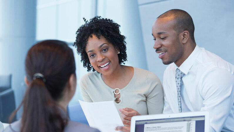 Black couple with loan officer