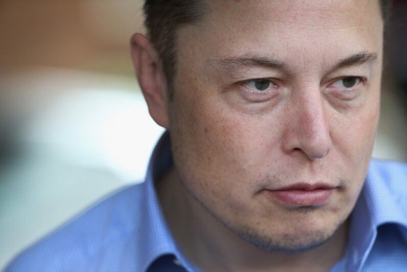 In addition to taking over the world, Tesla Motors CEO Elon Musk wants to provide global WiFi access -- for a profit. Scott Olson/Getty Images