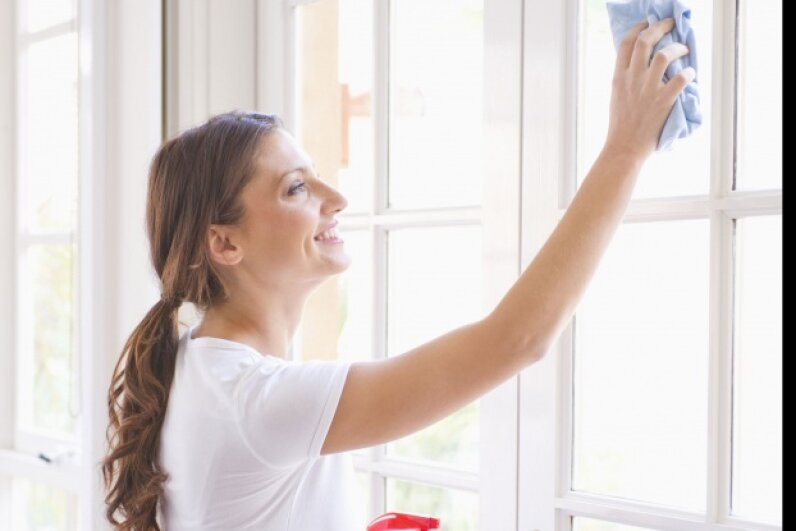 Cleaning the windows on a sunny day is counterproductive -- the heat of the sunlight  contributes to streaking.  © Dave and Les Jacobs/Blend Images/Corbis