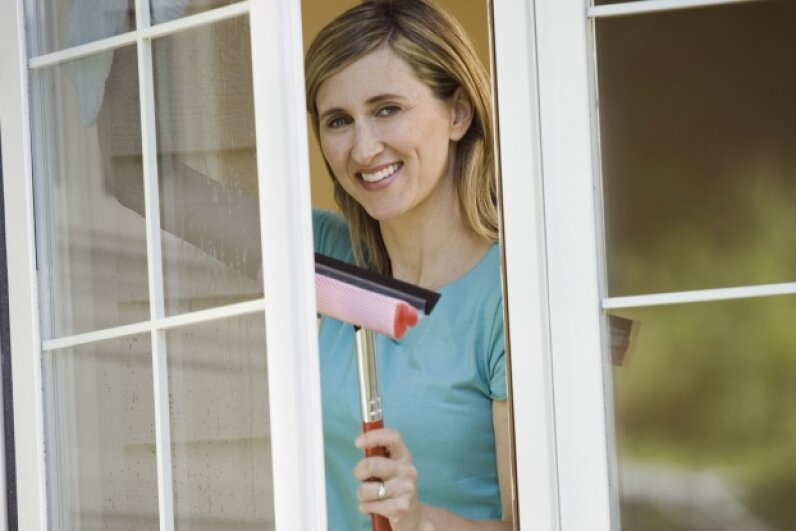 Squeegees aren't just for window exteriors -- they're perfect for indoors as well. © Corbis