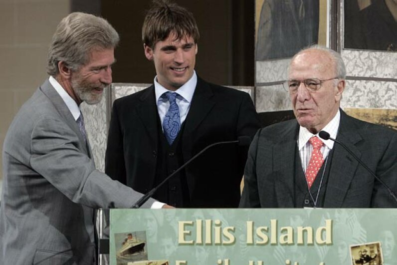 Robert Mondavi (right) with his son Tim (left) and grandson Carlo during an awards ceremony on Ellis Island, NYC in 2005. The awards are given annually to Ellis Island immigrants or their descendants who excel in their professions. Stephen Chernin/Getty Images