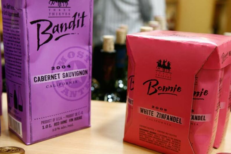 Red and purple cartons of Bandit wine displayed in the booth of a California dealer at a wine fair in Bordeaux, France.  Demand for environmentally friendly wine packaging is increasing. JEAN-PIERRE MULLER/AFP/Getty Images