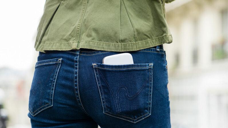 smartphone in women's pocket