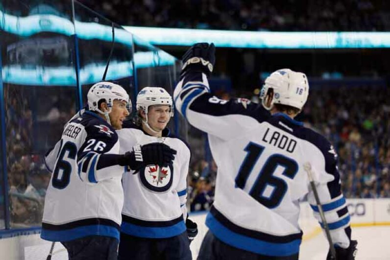 The Winnipeg Jets celebrate a win over the Tampa Bay Lightning in 2013. Looks like the irate caller's wish came true. Scott Iskowitz/Getty Images