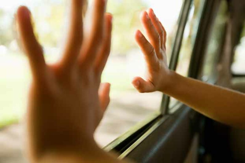 Forgetting how to open your own car door should not be a reason to call emergency services. Image Source/Getty Images