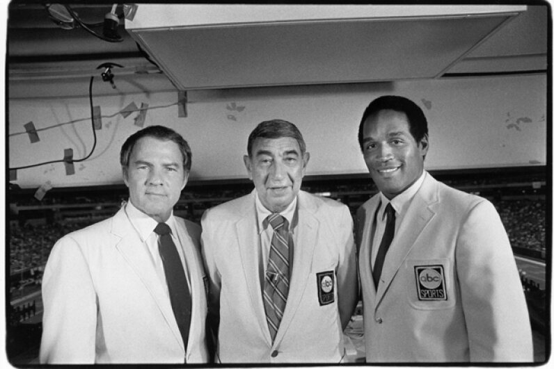 Monday Night Football broadcasters (L-R) Frank Gifford, Howard Cosell and O.J. Simpson pose for a photo in 1983 before a Vikings-Niners game. Michael Zagaris/Getty Images