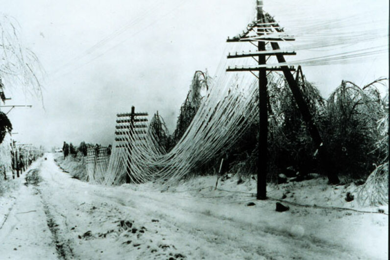 Heavy ice and snow damage telephone and telegraph lines.  Just one of the hazards of a heavy winter storm. See more storm pictures. NOAA