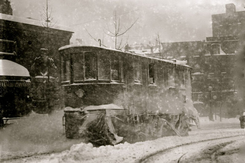 A trolley pushes through the snow and ice brought on by the Great Blizzard of 1888. This storm spurred the development of New York's subway system. Herbert A. French/Buyenlarge/Getty Images