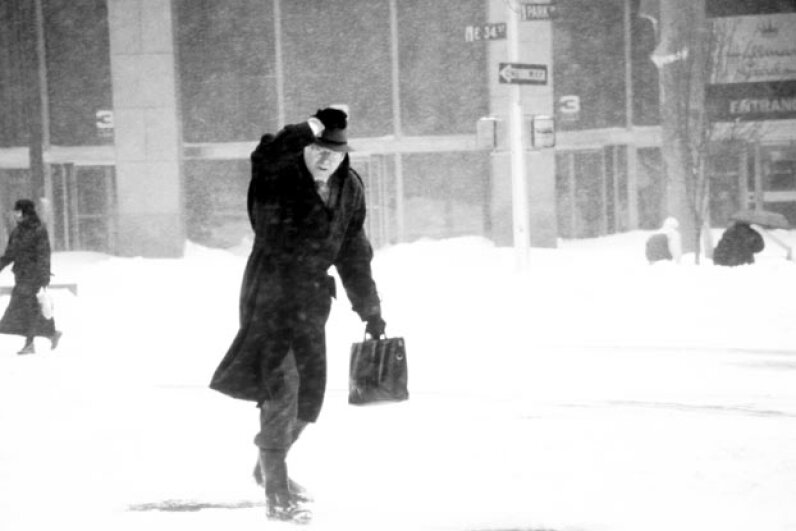 A man braves the elements during the blizzard of 1996. Patti McConville/Photographer's Choice/Getty Images