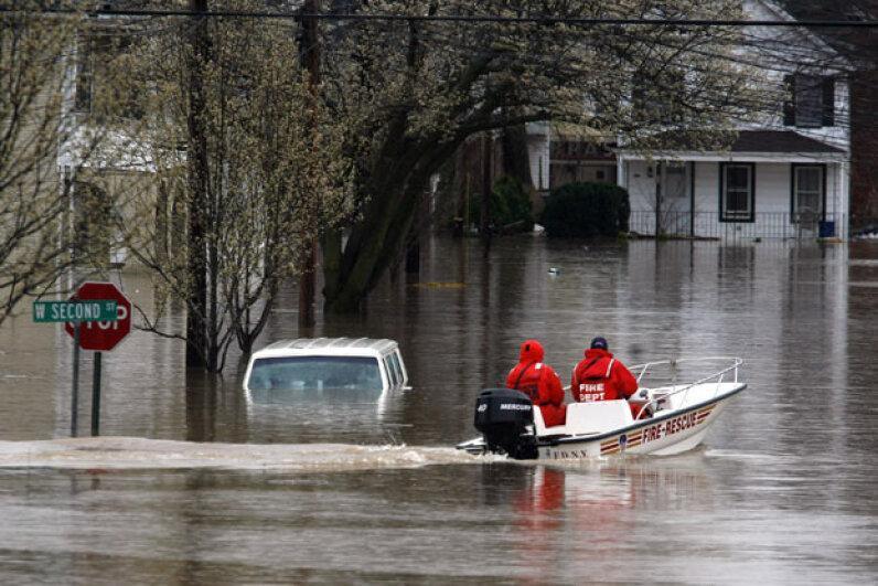 Rescue workers drive a FDNY boat past a van submerged in flood waters in New Jersey during the April 2007 nor'easter. Michael Nagle/Getty Images