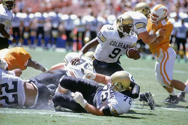 Wide receiver Mike Pritchard of the University of Colorado at Boulder carries the ball against the University of Tennessee in 1990; in another game that year, Colorado managed a rare fifth down which the referees didn't notice. Bernstein Associates/Getty Image