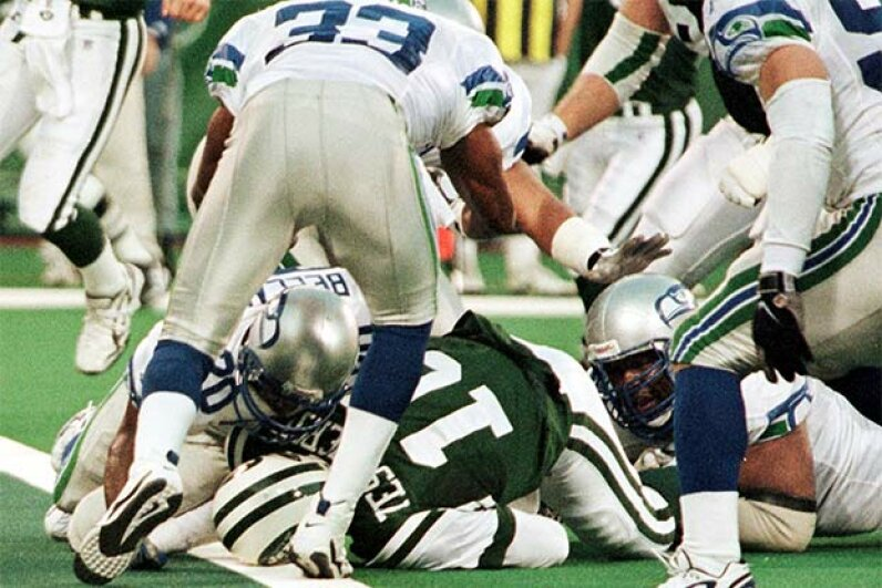 New York Jets quarterback Vinny Testaverde (green jersey) lies with his head on the goal line after being tackled by the Seattle Seahawks in 1998. The ref mistook his helmet for a ball and called a touchdown, giving victory to the undeserving Jets. MATT CAMPBELL/AFP/Getty Images