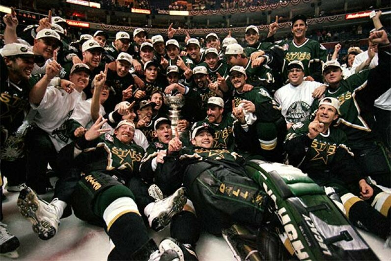 The Dallas Stars pose for a team photo with the Stanely Cup trophy as they celebrate the win over the Buffalo Sabres in 1999. Elsa Hasch /Allsport/Getty Images