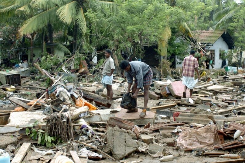 Sri Lankan residents pick through debris from a massive tidal wave. RAVEENDRAN/AFP/Getty Images