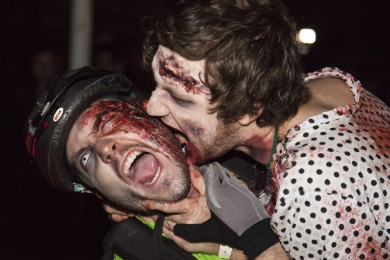 Biting is actually a pretty inefficient way to spread disease. It's especially pointless for one zombie to bite another. © redorbital ./Demotix/Corbis