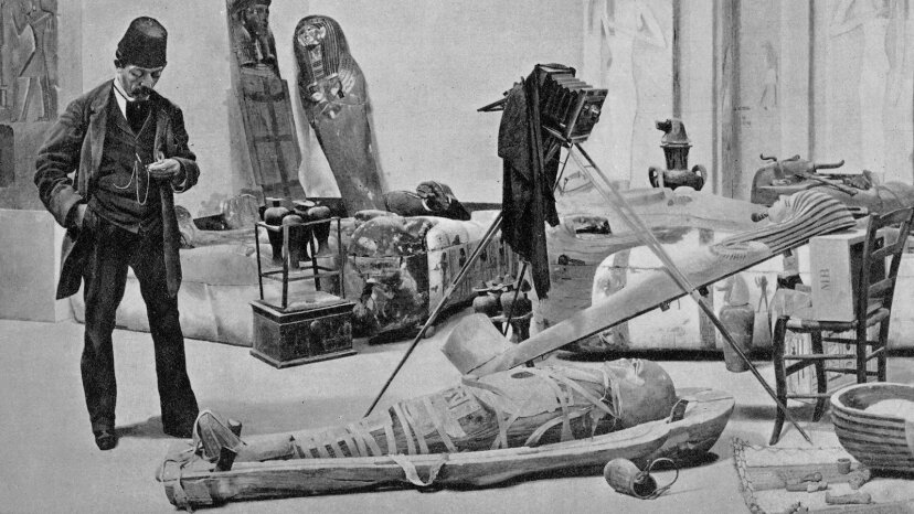 Man photographing a mummy