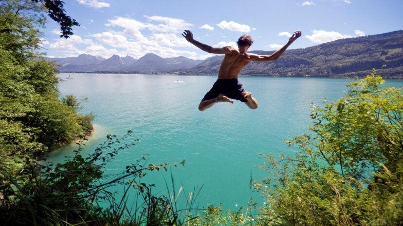 Guy jumping off cliff into water