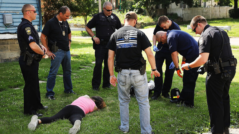 Medical workers and police treat a woman in Ohio who has overdosed on heroin. At least 4,149 Ohioans died from drug overdoses in 2016, a 36 percent increase from 2015, making Ohio the leader in U.S. overdose deaths. Spencer Platt/Getty Images