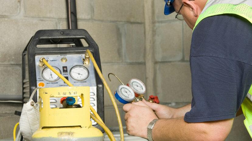 service tech removing refrigerant