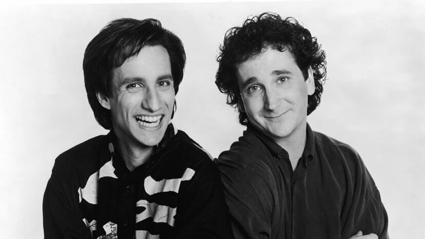 Bronson Pinchot (L) and Mark Linn-Baker lean against one another in a promotional portrait for the television series, 'Perfect Strangers.' Pinchot played a naïve shepherd with an unplaceable accent. Lorimar Television/Fotos International/Courtesy of Getty Images