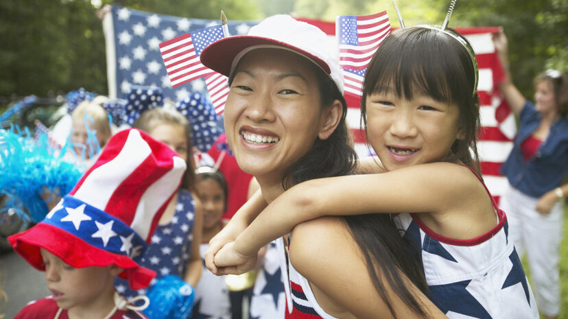 Americans display the nation's flag in many ways, and its many iterations, from decor to clothing, are on display in Independence Day parades around the country. Ariel Skelley/Blend Images/Getty Images
