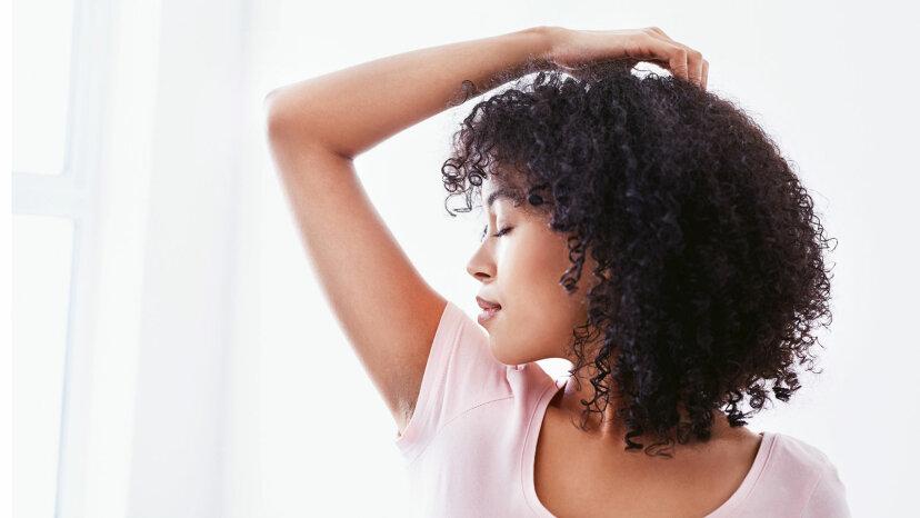 woman smelling armpits