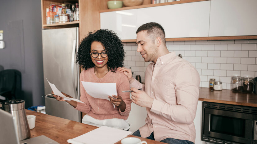 couple in kitchen looking at papers