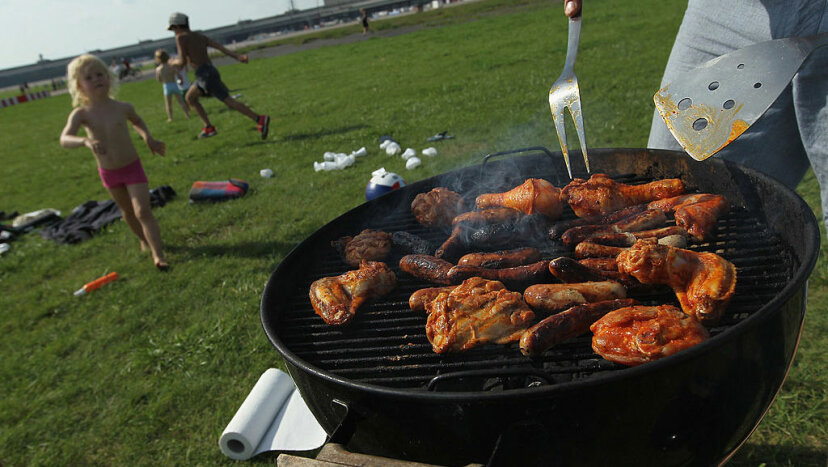 A family prepares barbecued chicken and sausages at the former Tempelhof airport in Berlin, Germany. Sean Gallup/Getty Images