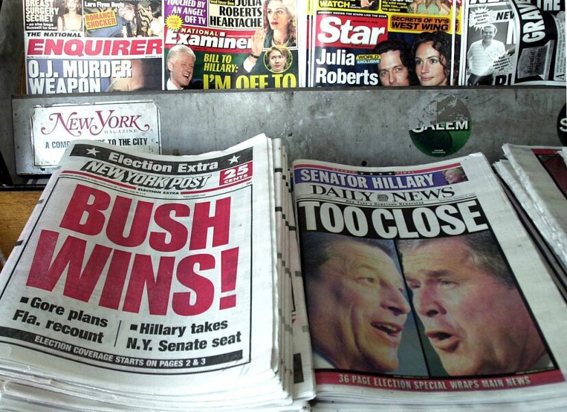 The New York Post proclaims George W. Bush the winner of the 2000 presidential election, while the New York Daily News is more circumspect, the morning after the election. It took more than a month to determine an official winner. HENNY RAY ABRAMS/AFP/Getty Images
