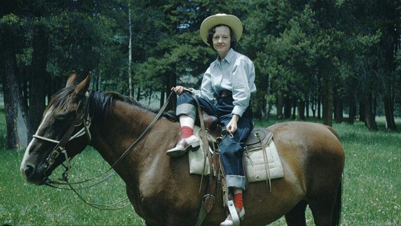 woman in cowboy hat, jeans