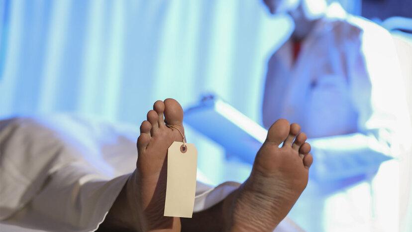 A body awaits examination in an autopsy bay
