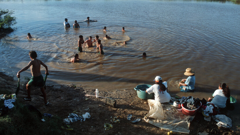 People swimming and washing clothes in Amazon River region