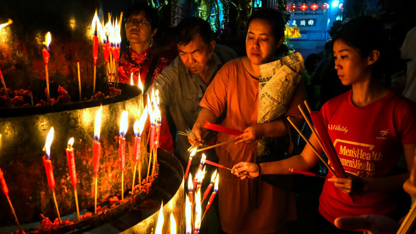 lighting candles, Kuan Yin Buddhist temple