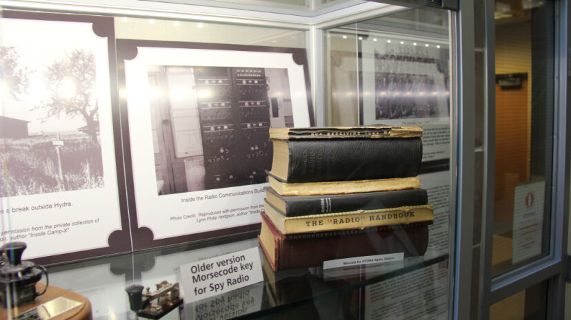 An exhibition of Camp X memorabilia features pictures of the radio communications building and manuals for Hydra. © 2012 Robert Bell/CC BY 2.0