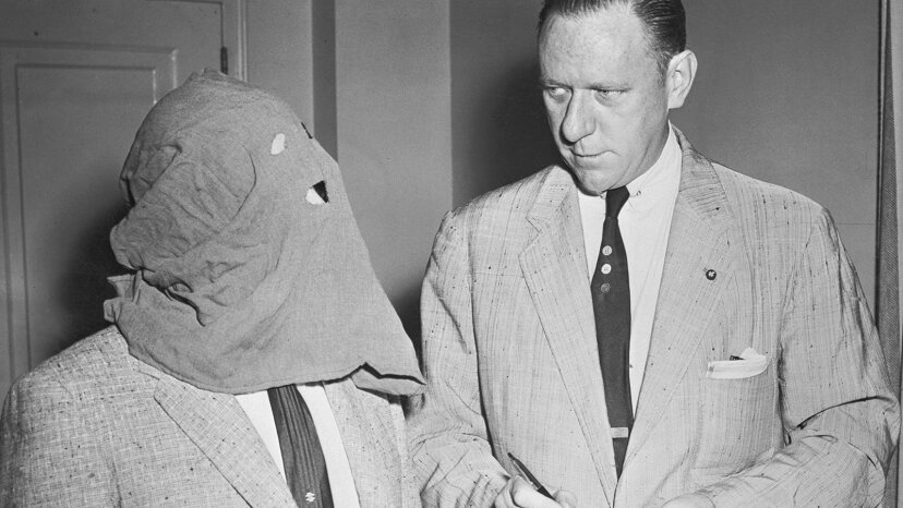 A reporter interviews former Russian cipher clerk Igor Gouzenko, who defected to Canada a few days after the end of World War II with info on Soviet spies. Gouzenko was interrogated at Camp X. Bettmann/Getty Images