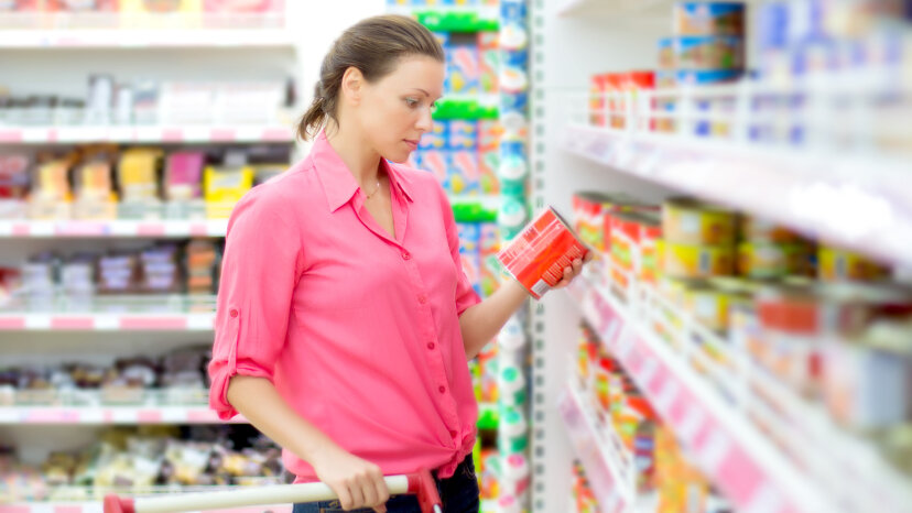 woman shopping for canned food