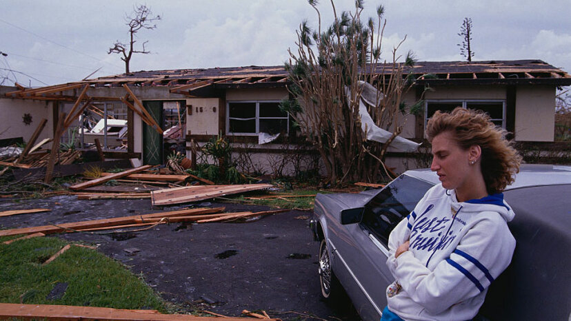 A young woman leans on a car during the aftermath of Hurricane Andrew in Miami. Andrew was a Category 5 hurricane that hit South Florida in 1992.  Steve Starr/CORBIS/Corbis via Getty Images