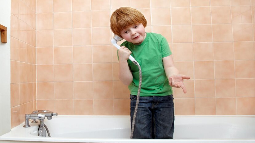 kid playing in shower