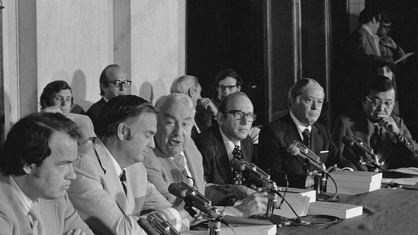 Members and staff of the Senate Watergate Committee gather in the caucus room to deliver their final report on their hearings, July 1974. © Wally McNamee/CORBIS/Corbis via Getty Images